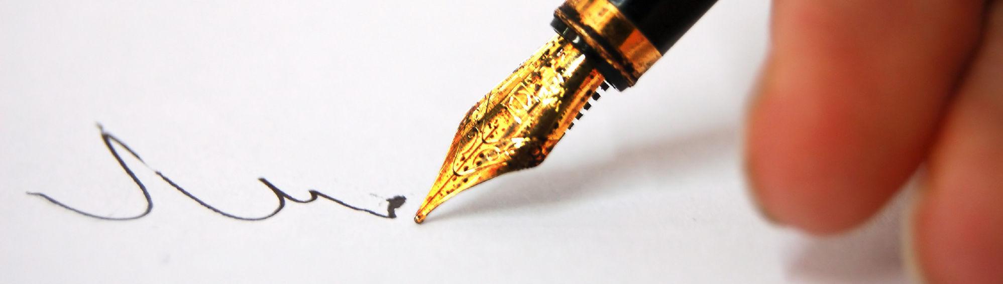 thoughtful-pen-writing-24581037-2560-1702 cropped 2560x726
