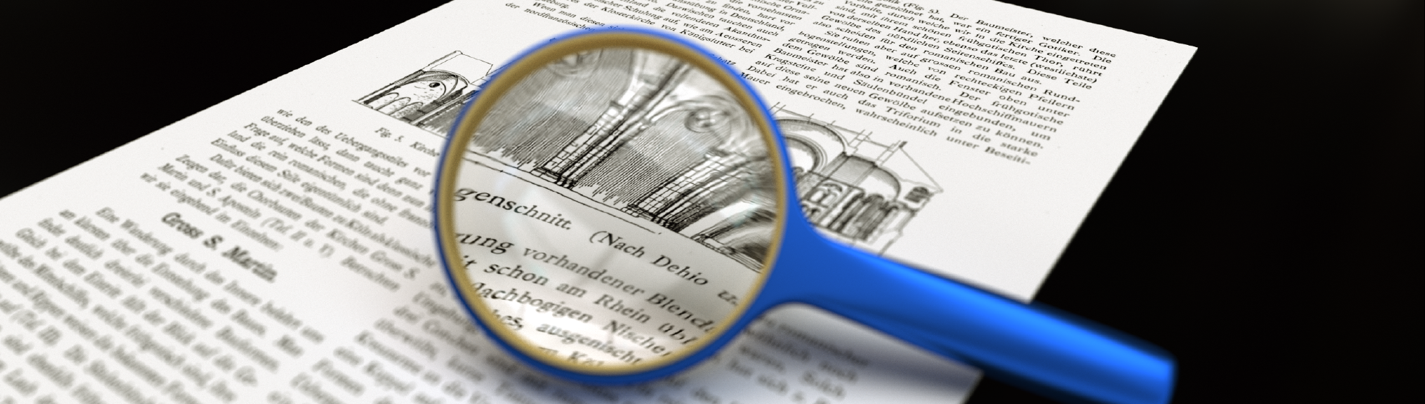 Magnifying_glass_with_focus_on_paper cropped 2600x738